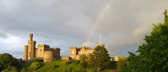 Inverness Castle with a rainbow behind it
